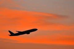 Aeroplane with beautiful sunset. Aeroplane on orange and beautiful sunset stock photo