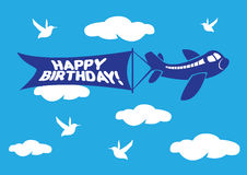 Aeroplane with birthday flying message banner. Royalty Free Stock Images