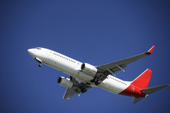 Aeroplane in blue sky. Photo of an aeroplane getting ready for landing stock photography