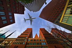 Aeroplane through the buildings stock photography