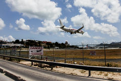Aeroplane Caribbean Airlines is landing on Princess Juliana Inte Stock Photos