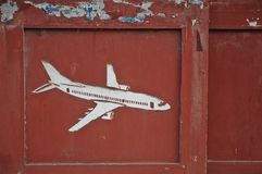 Aeroplane carved on old wooden door pane Royalty Free Stock Photo