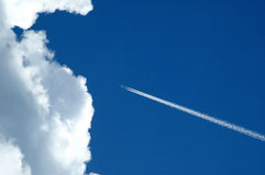Aeroplane and cloud Royalty Free Stock Photography