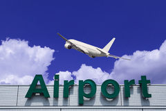 Aeroplane Clouds And Airport sign Royalty Free Stock Photography