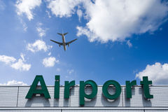 Aeroplane Clouds And Airport sign Stock Photography