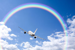 Aeroplane Clouds And Rainbow Royalty Free Stock Photos