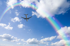 Aeroplane Clouds And Rainbow Royalty Free Stock Photography
