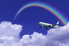 Aeroplane Clouds And Rainbow Stock Image
