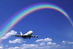 Aeroplane Clouds And Rainbow Stock Photos