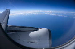 Aeroplane Clouds Window Sky. Clouds and sky through window of an aircraft Stock Image
