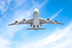 Aeroplane flying in the blue sky royalty free stock images