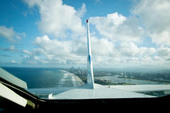 Aeroplane Flying over Gold Coast Australia Tail View. Aeroplane Flying over Gold Coast Australia looking through the rear window at the vertical and horizontal Royalty Free Stock Photos