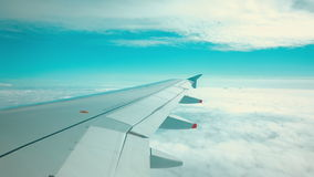 Aeroplane flying over two layers of clouds stock video