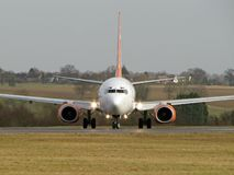 Aeroplane on front. View of the passenger aeroplane of front royalty free stock photo