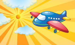 Aeroplane and light rays in the sky Stock Photo