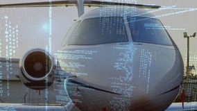 Aeroplane parked at an airport. Front view of an aeroplane parked at an airport. Digital animation of interface codes are running in the foreground stock video