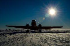 Aeroplane Silhouette. Basler DC3. ski-equipped propeller Aeroplane silhouette in Antarctica Royalty Free Stock Image