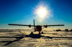 Aeroplane Silhouette. De havilland twin otter. ski-equipped propeller Aeroplane silhouette in Antarctica Stock Image