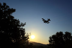 Aeroplane spraying mosquitos Royalty Free Stock Image