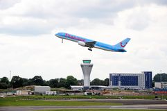 Aeroplane taking off over control tower, Birmingham. Royalty Free Stock Image