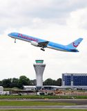 Aeroplane taking off over control tower, Birmingham. Royalty Free Stock Photos
