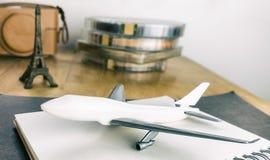 Aeroplane and travel equipment to Paris. Aeroplane and vintage travel equipment to Paris royalty free stock photo