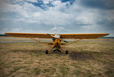 Aeroplane waiting for a start, on grass Royalty Free Stock Images
