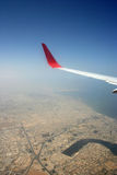 Aeroplane wing. Areal view of the Gulf region from the aeroplane Stock Photo