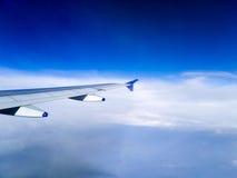 Aeroplane wing among clouds Royalty Free Stock Photos