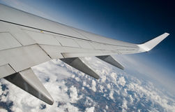 Aeroplane wing in the sky. Royalty Free Stock Photos