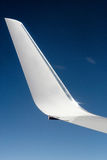 Aeroplane wing with sky background Royalty Free Stock Image