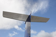 Aeroplane wing tale viewed from below with blue sky Stock Images