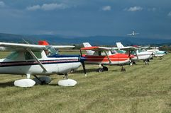 Aeroplanes. Several aeroplanes on land, landing plane in background, air show Stock Photo