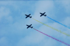Aeroplanes Teamwork. Three aeroplanes  perform during Indian navy's air show at Gateway of India Stock Photo