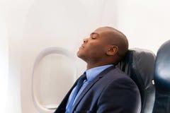 Aeroplano africano del hombre de negocios Imagen de archivo libre de regalías