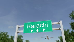 Aeroplano che arriva all'aeroporto di Karachi Viaggiando alla rappresentazione concettuale 3D del Pakistan Immagine Stock