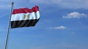 Aeroplano che sorvola bandiera d'ondeggiamento dell'Egitto video d archivio