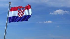 Aeroplano che sorvola bandiera d'ondeggiamento della Croazia stock footage