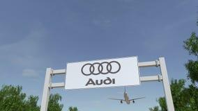 Aeroplano che sorvola il tabellone per le affissioni di pubblicità con il logo di Audi 3D editoriale che rende clip 4K video d archivio