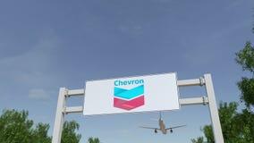Aeroplano che sorvola il tabellone per le affissioni di pubblicità con il logo di Chevron Corporation 3D editoriale che rende cli illustrazione vettoriale