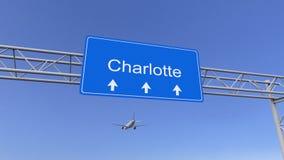 Aeroplano commerciale che arriva all'aeroporto di Charlotte Viaggiando alla rappresentazione concettuale 3D degli Stati Uniti Immagine Stock Libera da Diritti