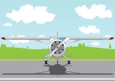 Aeroplano de la historieta en el campo de aviación Imagen de archivo libre de regalías