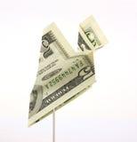 Aeroplano de papel de la cuenta de dólar cinco Foto de archivo libre de regalías