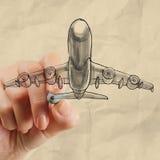 Aeroplano del dibujo de la mano con el fondo de papel arrugado Imagenes de archivo
