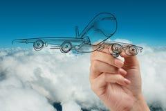 Aeroplano del dibujo de la mano en el cielo azul Imágenes de archivo libres de regalías