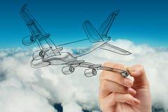 Aeroplano del disegno della mano su cielo blu Immagine Stock