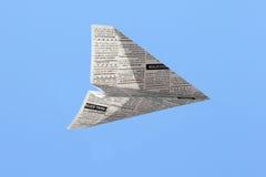 Aeroplano del giornale Fotografie Stock