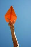 Aeroplano di carta arancione Fotografia Stock