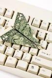 Aeroplano di carta del dollaro Fotografia Stock