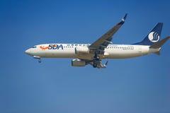 Aeroplano di Shandong Airlines Fotografie Stock
